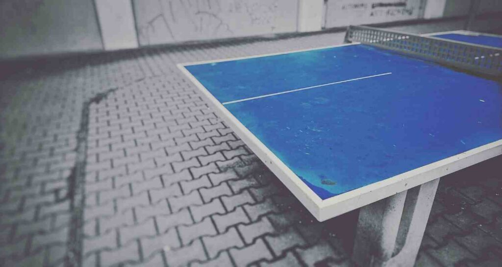 playing on outdoor ping pong tables (not on rainy days)
